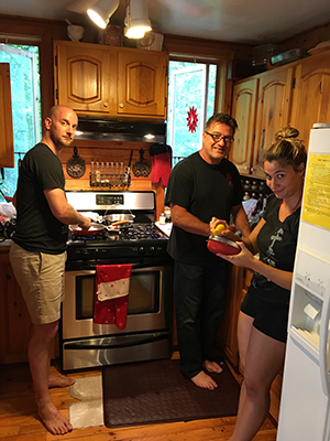 The Pittsburgh contingent cooking a gourmet meal for the group Friday night: Brian Buirge, Terry Valentino and Nikki Frank.